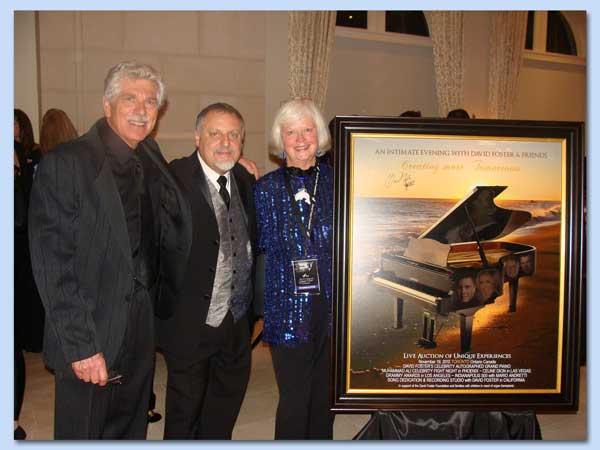 Warren, Maarten, and Nadina with Stuart Day's Inspired Poster of Warren's piano.